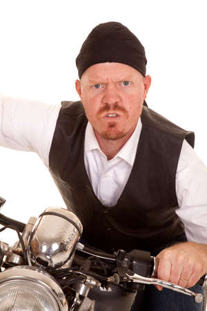 A man on a motorcycle with a mean expression on his face.