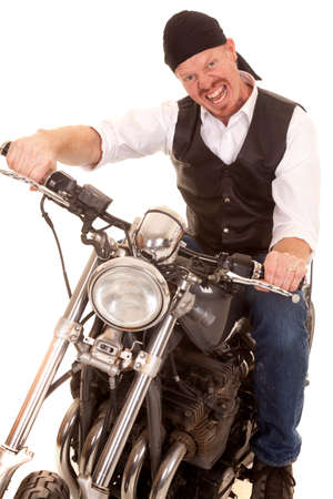 A man on a motorcycle making a crazy face expression. photo