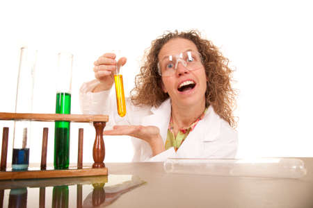 A crazy woman scientist with some test tubes full of colored liquid. photo