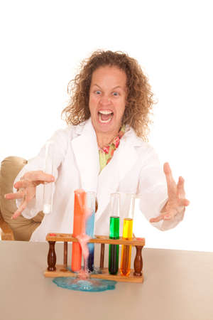 A crazy scientist woman with test tubes foaming over. photo