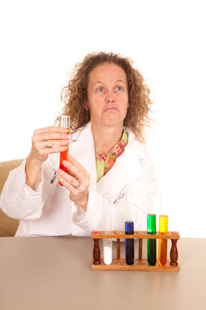 A crazy woman with test tubes and a frown on her face. photo