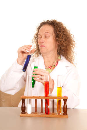 A woman scientist with a test tube making sour face expression. photo