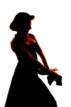 A silhouette of a woman holding out her hands. photo