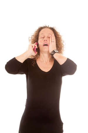 A woman talking on her phone with a shocked upset expression. photo