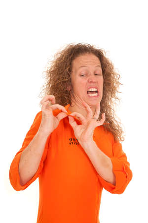 inmate: A woman inmate looking at her collar with a funny expression on her face,