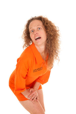 inmate: A woman in her inmate clothes with a funny expression on her face.