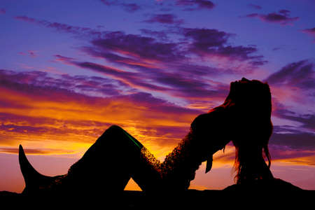 a silhouette of a mermaid leaning back. Stock Photo