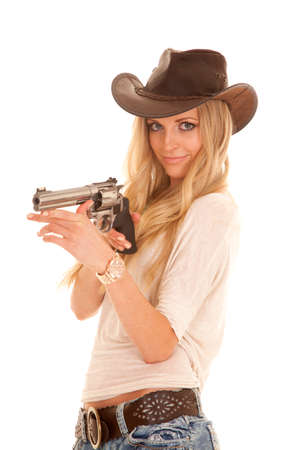 mischevious: A cowgirl with a mischevious expression on her face pointing her pistol.