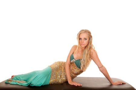 a woman in her mermaid costume laying with a sensual expression. photo