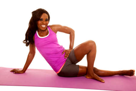 An African American sitting on her fitness mat stretching. Stock Photo - 28113175