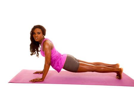 An African American stretching out on her fitness mat. Stock Photo - 28138695