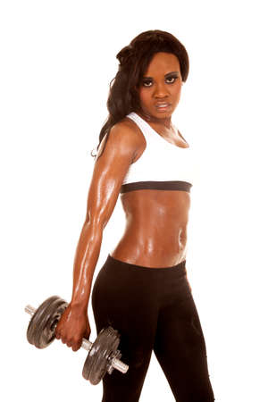 A woman in her fitness clothing holding on to a weight Stock Photo - 28119296