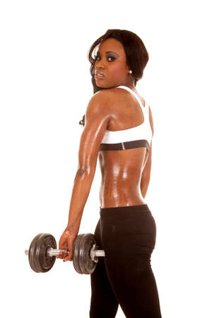 An African American working out with weights. Stock Photo - 28119297