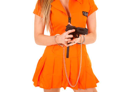 A woman in her orange jail suit with handcuffs on. Stock Photo - 28112652