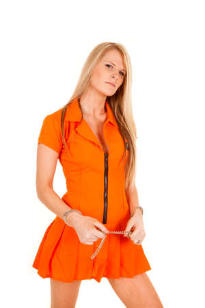 A woman in her orange jump suit wearing handcuffs