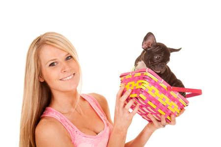 A woman with a puppy in her Easter basket. photo