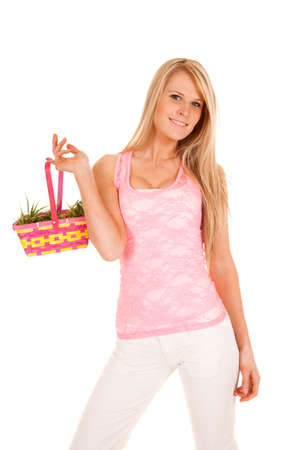 a woman holding on to her Easter basket with a smile on her face. photo