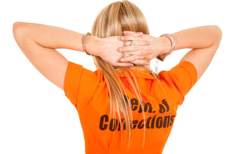 cuffs: A woman in her orange jump suit wearing handcuffs