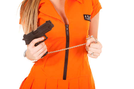 a woman in her orange jump suit wearing hand cuffs. photo