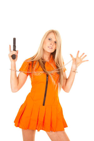 A woman prisioner with her hands up, she is holding on to a weapon. Stock Photo - 28074405