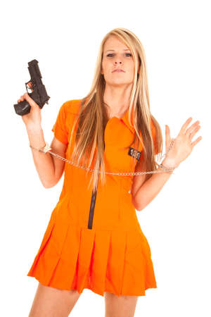 A woman prisioner with her hands up, she is holding on to a weapon. photo