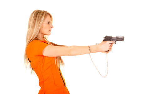 A woman prisoner holdingon to her weapon. Stock Photo - 28074403