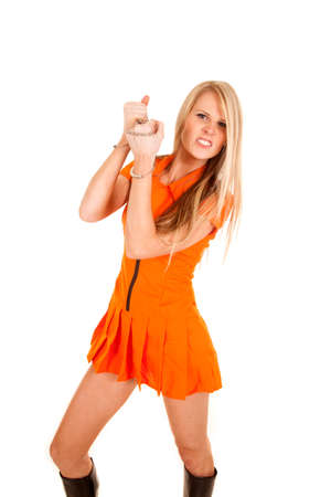 A woman in her orange jumpsuit wearing her handcuffs. Stock Photo - 28112647