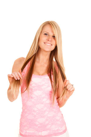 A woman in her pink lace top with a smile on her face. photo