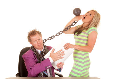A woman pulling on a mans chain while he is sad holding on to his laptop.