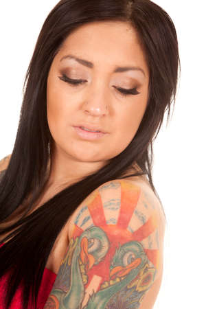 a woman looking over her shoulder that has a tattoo on it. photo