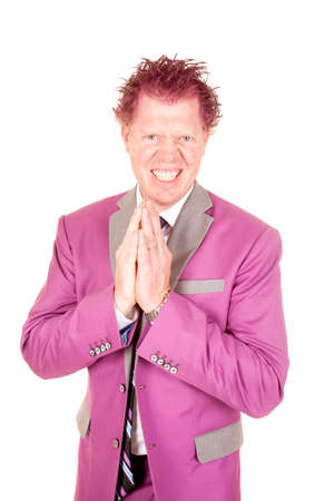 mischevious: A man in his purple suit with a mischevious expression on his face. Stock Photo