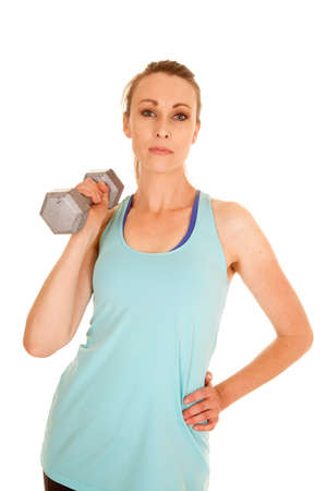a woman working out with a weight with a serious expression on her face. photo