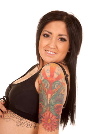 A woman looking over her shoulder showing off her tattoo. photo