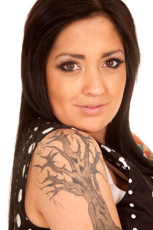 a woman looking over her shoulder with a tree tattoo. photo