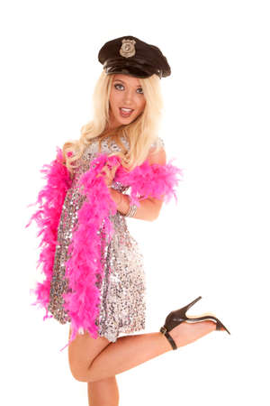 A woman in her silver dress with a pink feathered boa and police cap on. photo