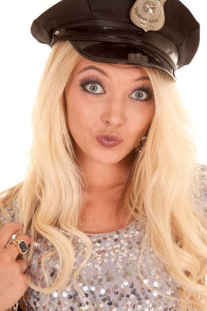 puckered lips: A woman in her police hat with her lips puckered.