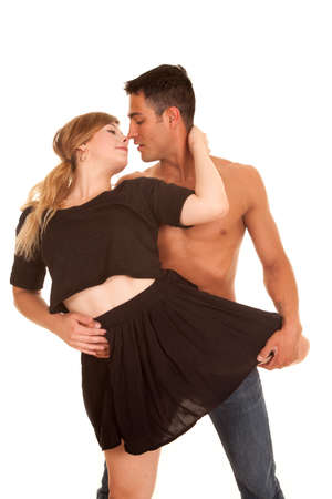 A woman and man dancing with her leg around her waist getting ready to kiss. Banco de Imagens