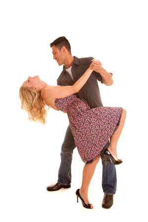 down beat: A man and woman dancing he is looking down at her.