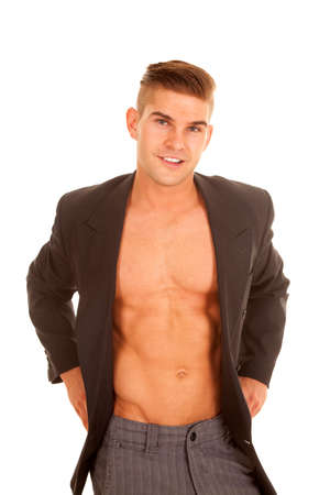 without clothes: a man in his dress clothes wearing his business jacket without a shirt