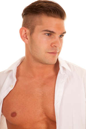 shirt unbuttoned: a man with his shirt unbuttoned looking to the side.