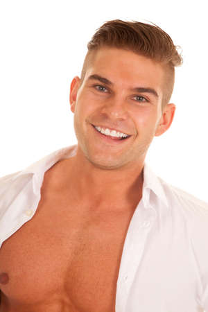 shirt unbuttoned: A man with a smile on his face with his shirt unbuttoned.