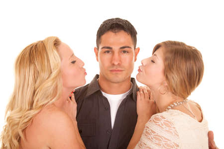 blond hair: A man with a serious expression getting ready for two women kissing him. Stock Photo