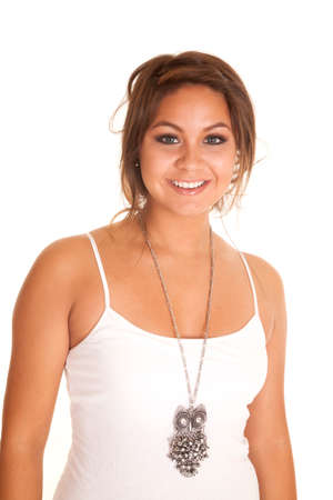 native american girl: A woman with a smile on her lips, wearing a necklace with an owl pendant.