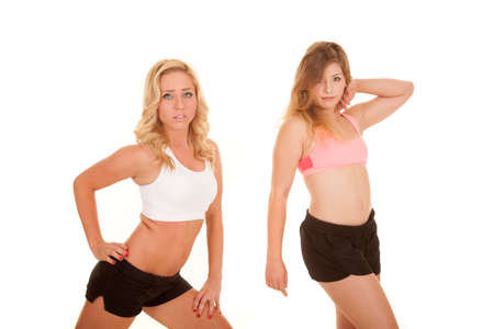 bod: two women in their fitness clothes showing off their bodies. Stock Photo