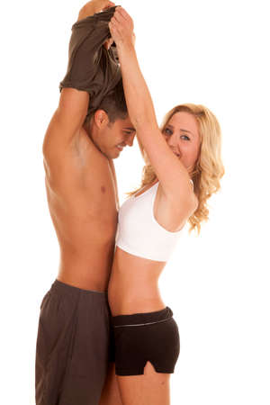 wanting: A woman wanting her man without a shirt on to exercise, taking off his shirt.