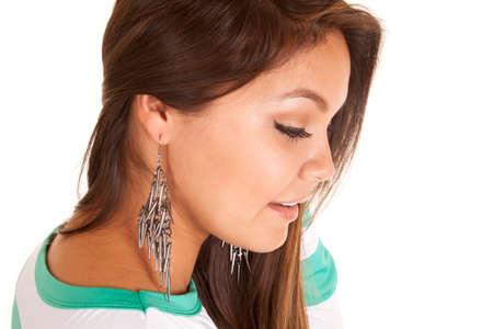 dangle: A woman looking to the side, wearing dangle earrings. Stock Photo