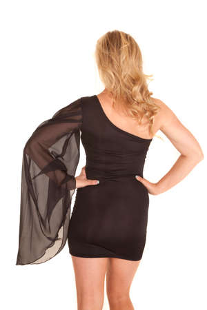 sleeve: A woman in a formal short dress with a big sheer sleeve. Stock Photo