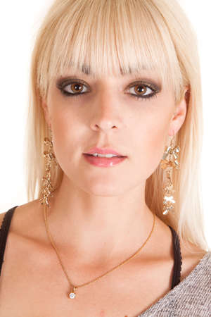 dangle: a close up of a woman wearing dangle earrings and a necklace with a diamond. Stock Photo