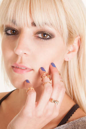 A woman with a sensual expression on her face, with rings on her fingers. photo