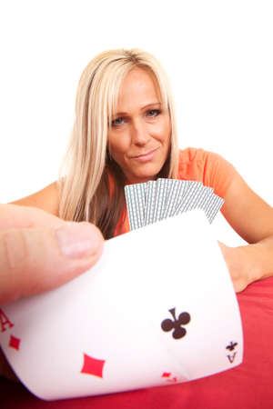 A close up of a poker hand, two people playing together. photo